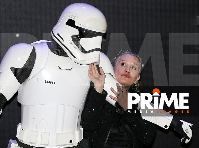 Original Star Wars Actress carrie Fisher poses with a stormtrooper during the STAR WARS: 'The Force Awakens' EUROPEAN PREMIERE at Odeon, Empire & Vue Cinemas, Leicester Square, England on 16 December 2015. Photo by David Horn / PRiME Media Images