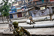 Soldiers from the Central Reserve Police Force (CRPF) and J&K Police move forward towards the Kashmiri demonstrators during a clash with them in downtown Srinagar on May 8, 2009. Separatists oppose the holding of elections in Kashmir, arguing that they will not resolve the future of the disputed territory, held in part by India and Pakistan but claimed in full by both...Kashmir went into polls on the 4th round of Indian general elections. About 26 percent polling was recorded in the Indian parliamentary elections held in Kashmir on Thursday, May 7th 2009. The poll percentage was on the higher side this year as compared to 2004 polls when 15.04 percent polling was recorded.