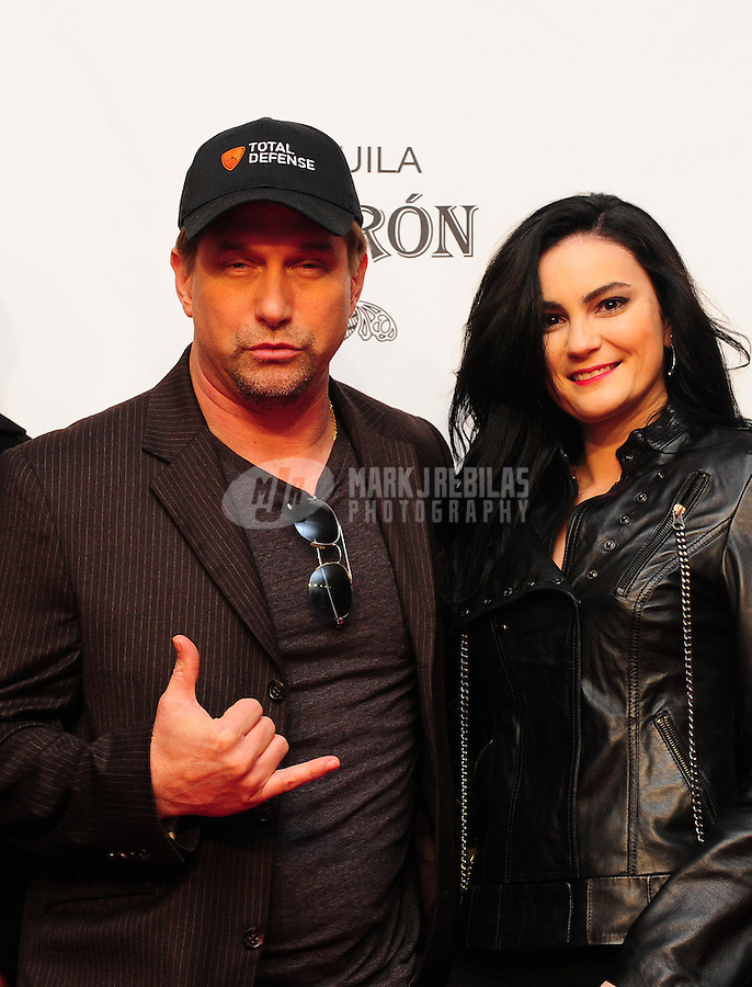 Feb 4, 2012; Indianapolis, IN, USA; Movie actor Stephen Baldwin (left) with a female companion in attendance at The Maxim Party at Indiana State Fairgrounds Mandatory Credit: Mark J. Rebilas-