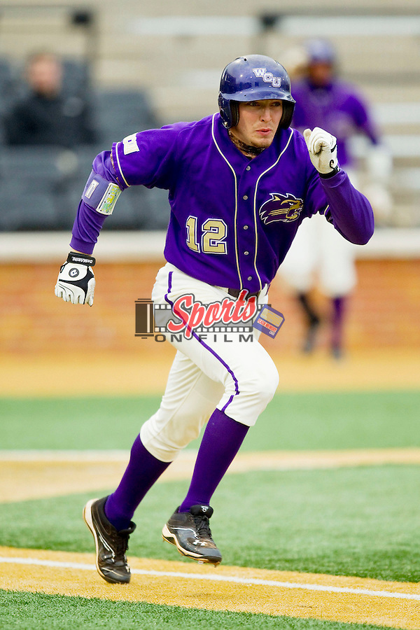 Cody Jones (12) of the Western Carolina Catamounts hustles down the first base line against the Wake Forest Demon Deacons at Wake Forest Baseball Park on March 26, 2013 in Winston-Salem, North Carolina.  The Demon Deacons defeated the Catamounts 3-1.  (Brian Westerholt/Sports On Film)