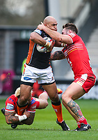 Picture by Alex Whitehead/SWpix.com - 19/03/2017 - Rugby League - Betfred Super League - Salford Red Devils v Castleford Tigers - AJ Bell Stadium, Salford, England - Castleford's Jake Webster is tackled by Salford's Junior Sa'u and George Griffin.
