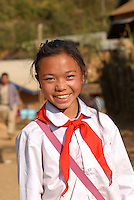 Laos, Hmong village Nam Kha , young girl with red Pioneer scarf of the communist Pioneer movement / Laos, Hmong Dorf Nam Kha ,junges Maedchen mit rotem Halstuch der komunistischen Pionierorganisation