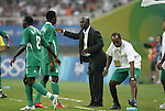 19 August 2008: Nigeria head coach Samson Siasia (NGA) (in black) talks with Solomon Okoronkwo (NGA).  The men's Olympic soccer team of Nigeria defeated the men's Olympic soccer team of Belgium 4-1 at Shanghai Stadium in Shanghai, China in a Semifinal match in the Men's Olympic Football competition.