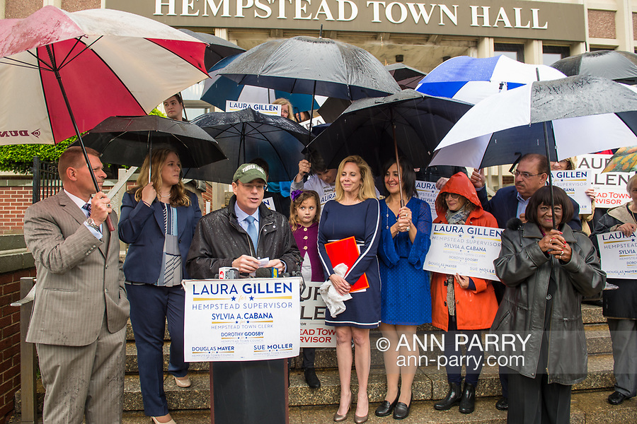 Hempstead, New York, USA. May 22, 2017. Democrats announce Town of Hempstead slate: LAURA GILLEN for Town Supervisor, DOROTHY GOOSBY (1st D), SUE MOLLER (6th D), DOUGLAS MAYER (4th D) for Hempstead Town Board, and SYLVIA CABANA Hempstead Town Clerk. Press Conference was at Hempstead Town Hall front entrane steps during strong rain.