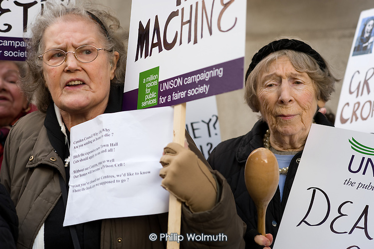Users of Age Concern Camden's three resource centres demonstrate outside Camden Town Hall following  the council's decision to cut funding and close them down.