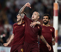 Calcio, Serie A: Roma vs Juventus. Roma, stadio Olimpico, 14 maggio 2017. <br /> Roma&rsquo;s Radja Nainggolan, center, celebrates with teammates Stephan El Shaarawy, left, and Mohamed Salah after scoring during the Italian Serie A football match between Roma and Juventus at Rome's Olympic stadium, 14 May 2017. Roma won 3-1.<br /> UPDATE IMAGES PRESS/Isabella Bonotto