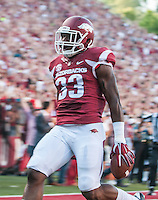 STAFF PHOTO ANTHONY REYES • @NWATONYR<br /> Korliss Marshall of Arkansas celebrates a kickoff return for a touchdown against Northern Illinois University Saturday, Sept. 20, 2014 at Razorback Stadium in Fayetteville.