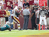 Landover, MD - September 9, 2007 -- Washington Redskins running back Clinton Portis (26) scores a third quarter touchdown against the Miami Dolphins at FedEx Field in Landover, Maryland on Sunday, September 9, 2007.  The Redskins won the game in overtime 16 - 13..Credit: Dexter Powell / CNP
