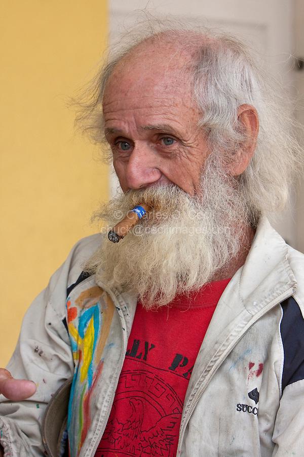 "Cuba, Cienfuegos.  Julian Espinosa, an untrained, ""primitive"" artist known as ""Wayacon"" (""little frog""), with a Cigar."