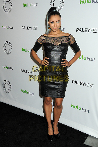 "Kat Graham.PaleyFest 2012 Presents ""The Vampire Diaries"" held at the Saban Theatre. Beverly Hills, California, USA, .10th March 2012.full length off the shoulder sheer leather dress  black  corset bustier hands on hips .CAP/ADM/BP.©Byron Purvis/AdMedia/Capital Pictures."