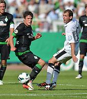 FUSSBALL   DFB POKAL   SAISON 2012/2013   1. Hauptrunde Preussen Muenster - Werder Bremen              19.08.2012 Zlatko Junuzovic (SV Werder Bremen)  gegen Amaury Bischoff (re, Muenster)