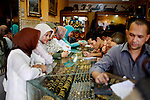 Women buy gold at one of the more popular gold shops, a sign of a strengthening economy, in Banda Aceh, Indonesia, on Thursday, Nov. 19, 2009.