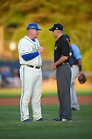 Hartford Yard Goats manager Darin Everson (41) discusses a call with umpire Ben Levin during the second game of a doubleheader against the Trenton Thunder on June 1, 2016 at Sen. Thomas J. Dodd Memorial Stadium in Norwich, Connecticut.  Trenton defeated Hartford 2-1.  (Mike Janes/Four Seam Images)