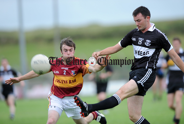 David Tubridy of Doonbeg and Enda Malone of St Joseph's in action during their Cusack Cup Semi Final at Quilty. Photograph by John Kelly.