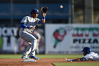 Daytona Cubs shortstop Marco Hernandez (11) takes a throw on a steal attempt during a game against the Dunedin Blue Jays on April 16, 2014 at Florida Auto Exchange Stadium in Dunedin, Florida.  Dunedin defeated Daytona 5-1.  (Mike Janes/Four Seam Images)
