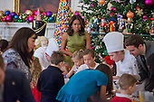 First lady Michelle Obama helps demonstrate holiday crafts and treats in the State Dining Room as they preview the 2015 White House Christmas decorations in the East Room of the White House in Washington, DC on Wednesday, December 2, 2015.  She was joined by military families who participated in the making of the crafts.<br /> Credit: Ron Sachs / CNP