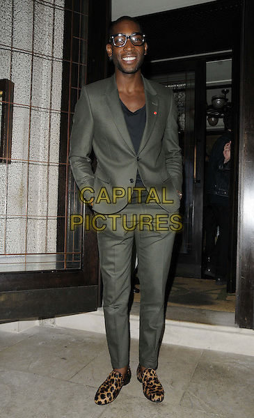 Tinie Tempah ( Patrick Chukwuemeka Okogwu )<br /> attended the Jonathan Newhouse &amp; Tommy Hilfiger dinner, 34 bar &amp; restaurant,  Grosvenor Square, London, England.<br /> June 17th, 2013<br /> full length black top grey gray suit glasses brown leopard print shoes hands in pockets   <br /> CAP/CAN<br /> &copy;Can Nguyen/Capital Pictures