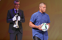Musician Stan Walker brings in the official match ball. Official Draw for the FIFA U 20 Football World Cup, New Zealand 2015. Sky City, Auckland. Tuesday 10 February 2015. Copyright photo: Andrew Cornaga / www.photosport.co.nz