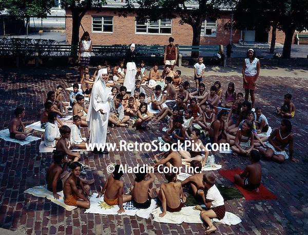 St. John Villa Academy, New York. A nun speaking to young children after a swim.