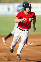 Adam Engel (23) of the Kannapolis Intimidators hustles towards third base against the Augusta GreenJackets at CMC-NorthEast Stadium on August 3, 2014 in Kannapolis, North Carolina.  The Intimidators defeated the GreenJackets 10-5. (Brian Westerholt/Four Seam Images)