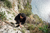 Mount Athos - The Holy Mountain.<br /> A monk climbs the cliffs of Karoulia to visit a friend.