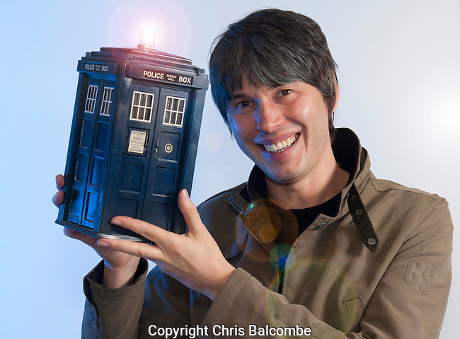 Professor Brian Cox holds a model Tardis from the Doctor Who sci-fi series. He has appeared in an episode, and often talks of time travel in his lectures.<br />