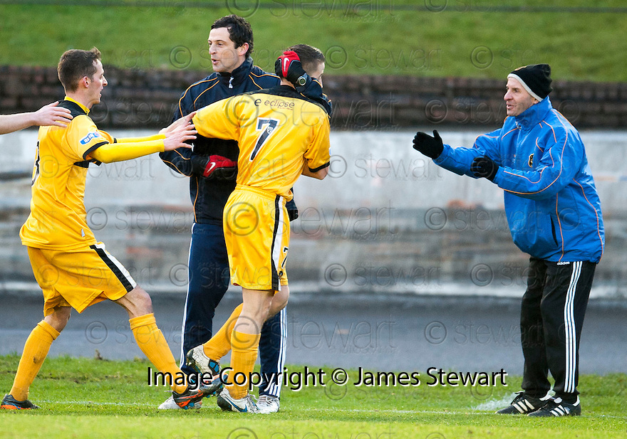 Dumbarton's Mark Gilhaney (7) celebrates with Manager Jack Ross after he scores Dumbarton's first goal ...