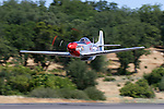 "Dan Martin pilots his P-51D Mustang ""Ridge Runner"" on a low pass down the runway during the 2007 Father's Day Fly In at Columbia Airport in Columbia, California. The P-51 Mustang is considered to be the premier fighter of the World War II and many are kept in flying condition by their civilian owners. Photographed 06/07"