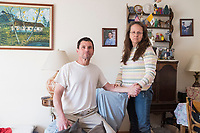 Carlos Arredondo, 57, (left) and his wife Melida Arredondo, 52, stand in their living room in Roslindale, Boston, Massachusetts, USA, on Sat., March 31, 2018. Arredondo is well known as the &quot;man in the cowboy hat&quot; who helped out in the aftermath of the Boston Marathon Bombing in 2013. <br /> <br /> Between the two is a picture of their son Brian Arredondo, who died by suicide in 2011 after a battle with depression following the 2004 death of Arrendondo's other son  Marine Lance Corporal Alexander Scott Arredondo, who was killed while serving in Iraq.