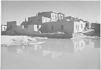 "Full side view of adobe house with water in foreground, ""Acoma Pueblo [National Historic Landmark, New Mexico]."";<br /> From the series Ansel Adams Photographs of National Parks and Monuments, compiled 1941 - 1942, documenting the period ca. 1933 - 1942.<br /> Date 	<br /> <br /> between 1933 and 1942"