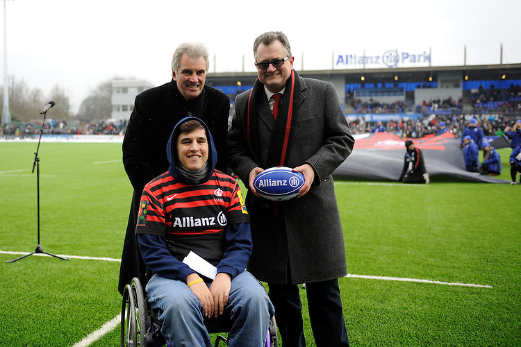 20130324 Copyright onEdition 2013©.Free for editorial use image, please credit: onEdition..(L-R) Nigel Wray, Chairman of Saracens, Henry Fraser and Clem Booth, member of the Allianz Board of Management before the Premiership Rugby match between Saracens and Harlequins at Allianz Park on Sunday 24th March 2013 (Photo by Rob Munro)..For press contacts contact: Sam Feasey at brandRapport on M: +44 (0)7717 757114 E: SFeasey@brand-rapport.com..If you require a higher resolution image or you have any other onEdition photographic enquiries, please contact onEdition on 0845 900 2 900 or email info@onEdition.com.This image is copyright onEdition 2013©..This image has been supplied by onEdition and must be credited onEdition. The author is asserting his full Moral rights in relation to the publication of this image. Rights for onward transmission of any image or file is not granted or implied. Changing or deleting Copyright information is illegal as specified in the Copyright, Design and Patents Act 1988. If you are in any way unsure of your right to publish this image please contact onEdition on 0845 900 2 900 or email info@onEdition.com