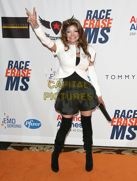 LA TOYA JACKSON.The 18th Annual Race To Erase MS Gala held at The Hyatt Regency Century Plaza Hotel in Century City, California, USA. .April 29th, 2011.full length jacket skirt shorts white  clutch bag hands glove arm bands warmers knee high thigh boots otk hand arm in air peace sign                                                             .CAP/RKE/DVS.©DVS/RockinExposures/Capital Pictures.