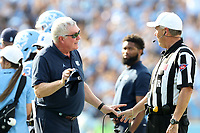 CHAPEL HILL, NC - SEPTEMBER 28: Head coach Mack Brown of the University of North Carolina talks to Referee Riley Johnson during a game between Clemson University and University of North Carolina at Kenan Memorial Stadium on September 28, 2019 in Chapel Hill, North Carolina.
