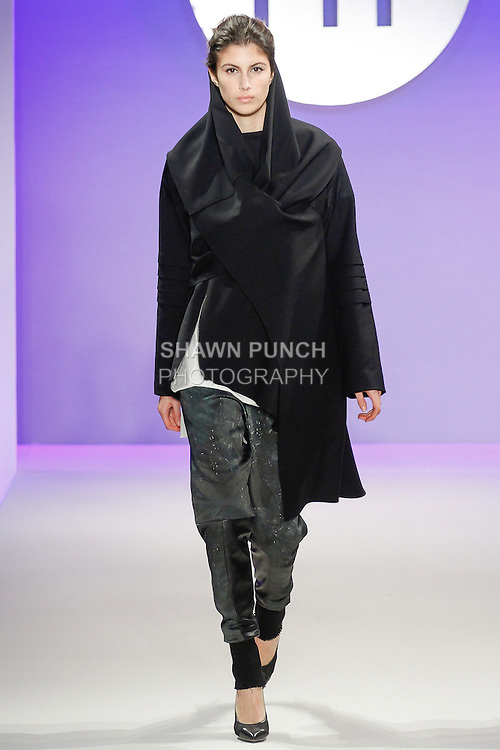 Model walks runway in an outfit by Elisa Rodriguez, during the FIT Future of Fashion 2014 Graduates' Collection fashion show, at the Fashion Institute of Technology on May 1, 2014.