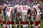 New York Giants quarterback Eli Manning (10) calls a play in the huddle during an NFC Championship NFL football game against the San Francisco 49ers on January 22, 2012 in San Francisco, California. The Giants won 20-17 in overtime. (AP Photo/David Stluka)