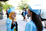 WATERBURY, CT- 21 June  2017-062117CM06- Waterbury Arts Magnet School graduates Alla Hashim tells Diosy Leo that she doesn't have a tassel during commencement exercises at the Palace Theater in Waterbury on Wednesday.  Christopher Massa Republican-American