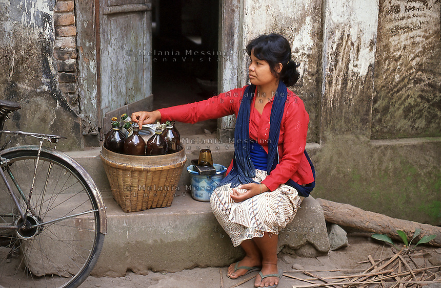 Indonesia, Java island, jamu seller offers her medicine in the village for primary health care.<br />