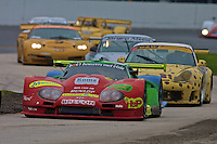 The #25 Marcos Mantara LM600 of Toto Lasally, Peter Van der Kolk and Miguel Angel de Castro leads line of cars through the chicane during the Rolex 24 at Daytona, Daytona INternational Speedway, Daytona Beach, FL, February 4, 2001.  (Photo by Brian Cleary/www.bcpix.com)