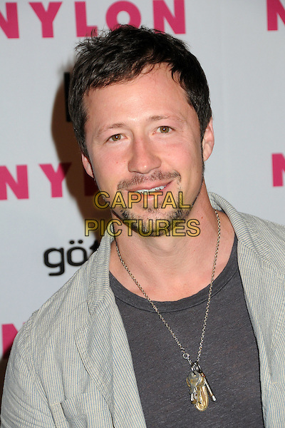 GREG ALTERMAN.Nylon Magazine's Young Hollywood Party held at the Roosevelt Hotel's Tropicana Bar, Hollywood, California, USA..May 12th, 2010.headshot portrait grey gray goatee facial hair necklace keys.CAP/ADM/BP.©Byron Purvis/AdMedia/Capital Pictures.