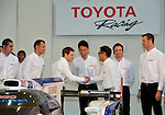 January 30, 2014, Tokyo, Japan - President Akio Toyoda of Japan's Toyota Motor Corp., shakes hands with drivers of its racing team during a presentation of the company's motor sports activities for 2014 in Tokyo on Thursday, January 30, 2014. They will include participation in the FIA World Endurance Championship and the Le Mans 24-hour race, the NASCAR racing series and the Super GT and Super Formula championships. Toyoda said its motor sports activities through Lexus Racing and Toyota Racing are aimed to bring more joy to more people through automobiles.  (Photo by Natsuki Sakai/AFLO)
