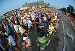 Runners break from the starting line near Lambeau Field during the Cellcom Green Bay Marathon on May 20, 2012.