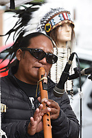NWA Democrat-Gazette/DAVID GOTTSCHALK Inti (cq), with Native Winds, plays Friday, October 4, 2019, a handmade flute during the 44th Annual Arkansas Apple Festival on the downtown square in Lincoln. The festival, that runs through Sunday, will feature activities that include a parade, apple core throwing and both bluegrass and gospel music.
