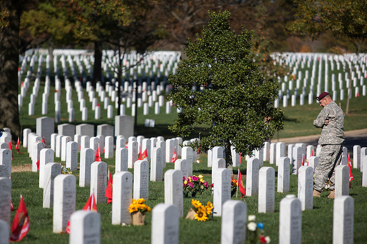 UNITED STATES - NOVEMBER 11 - A man stands alone near a grave at Section 60 during Veterans Day at Arlington National Cemetery, in Arlington, Va., Wednesday, November 11, 2015. (Photo By Al Drago/CQ Roll Call)