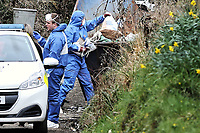"Pictured: Forensics officers empty contents to a recycling skip at the house in Aberaeron, where the remains of a woman have been discovered in Ceredigion County, Wales, UK. Wednesday 21 March 2018<br /> Re: Human remains have been found in a house following a police investigation to find a missing woman.<br /> Police were called to the property in Aberaeron, west Wales after a woman in her 50s collapsed.<br /> Police also discovered the woman's mother, in her 80s, who had not been seen for some time.<br /> The women were named locally as Gaynor and Valerie Jones, with police currently treating the death as unexplained.<br /> The two women have ben described as ""reclusive"" by neighbours and the home they shared as being ""heavily cluttered""."