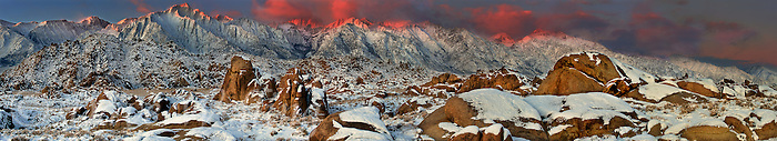902000009 panoramic view of winter sunrise alpenglow lighting up mount russell mount moran and the eastern sierras with snow covered granite boulders in the foreground in the alabama hills protected lands in kern county california