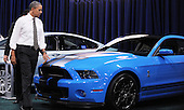 United States President Barack Obama looks at a Shelby during a visit to the DC Auto Show at the Walter E. Washington Convention Center in Washington, DC on January 31, 2012. .Credit: Olivier Douliery / Pool via CNP