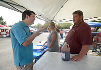 NWA Democrat-Gazette/BEN GOFF @NWABENGOFF<br /> Jeff Bobbitt (left) of Sonora talks to Rodney Pace from Lowell of team 'Butter n' Butts' while sampling Pace's brisket sauce Saturday, June 17, 2017, during the Rodeo of the Ozarks Western Days on the Shiloh Square in downtown Springdale. The event, held at Parsons Stadium in previous years, featured a barbecue cook off, stage coach rides, a battle of the bands and more.