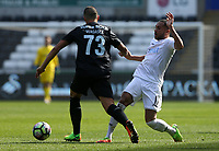 SWANSEA, WALES - MARCH 25:Diogo Verdasca of Porto is challenged by Kenji Gorre of Swansea City during the Premier League International Cup Semi Final match between Swansea City and Porto at The Liberty Stadium on March 25, 2017 in Swansea, Wales. (Photo by Athena Pictures)