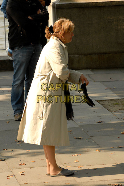 "EMMA THOMPSON .On the set of ""Last Chance Harvey"" refilming scenes near The Royal Festival Hall, Embankment, London, England..May 21st, 2008.film movie full length profile beige trench coat mac slippers shoes heels .CAP/IA.©Ian Allis/Capital Pictures."