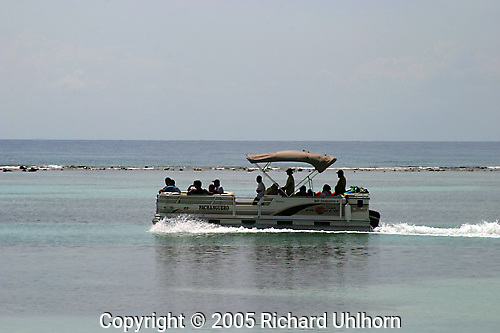 A dive boat returns to Costa Maya, Mexico, with a boat load of divers...Mexican Riveria, Caribbean, boat, diving, Caribbean sea